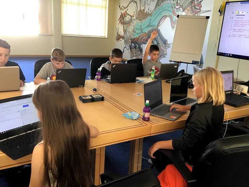 Children coding at a Summer of Code event