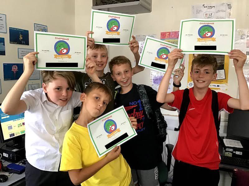 Children receiving certificates for Coding club