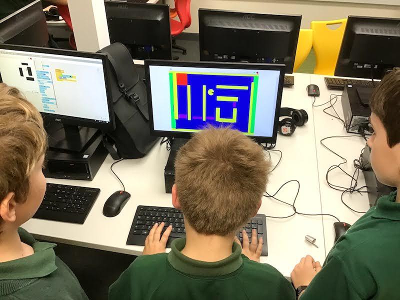 Children coding a Maze in Scratch