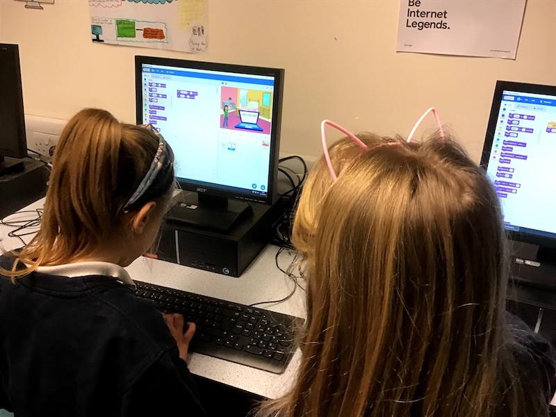 Girls coding at coding club